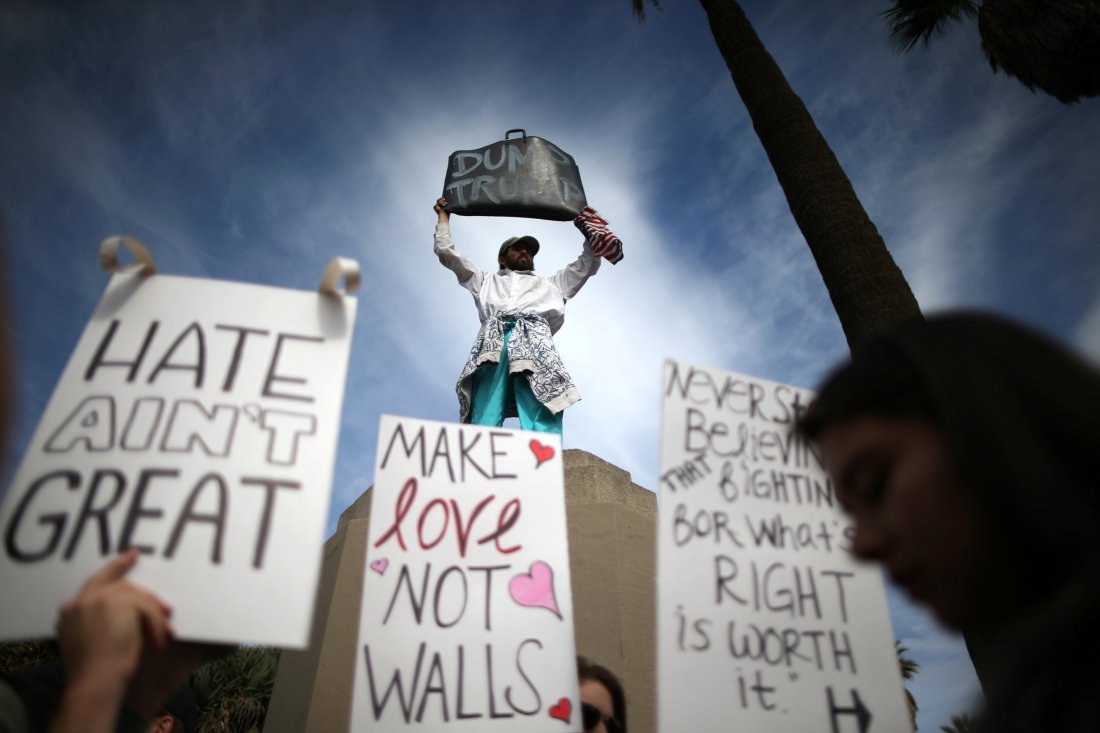 People hold signs during a march and rally against the election of Republican Donald Trump as President of the United States in Los Angeles, California, U.S. November 12, 2016. REUTERS/Lucy Nicholson TPX IMAGES OF THE DAY - RTX2TDMB